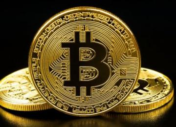 Джон МакАфи пересмотрел свой прогноз цены на биткоин: минимум 1 миллион к 2020 году (видео)